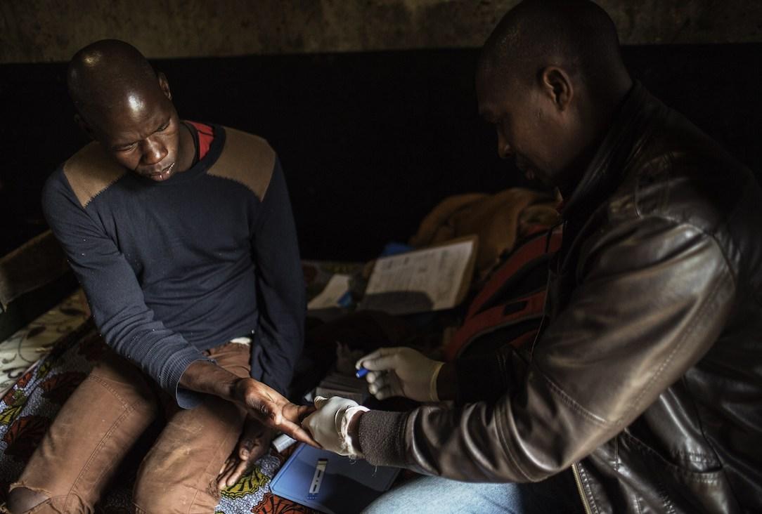 A worker receives an HIV test.