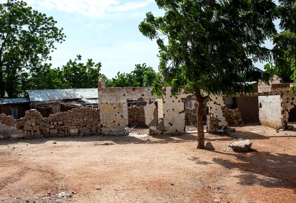 A building riddled with bullet holes in Pulka, Nigeria.