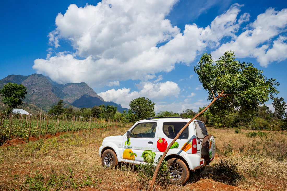 A nutrition NGO jeep in a crop field