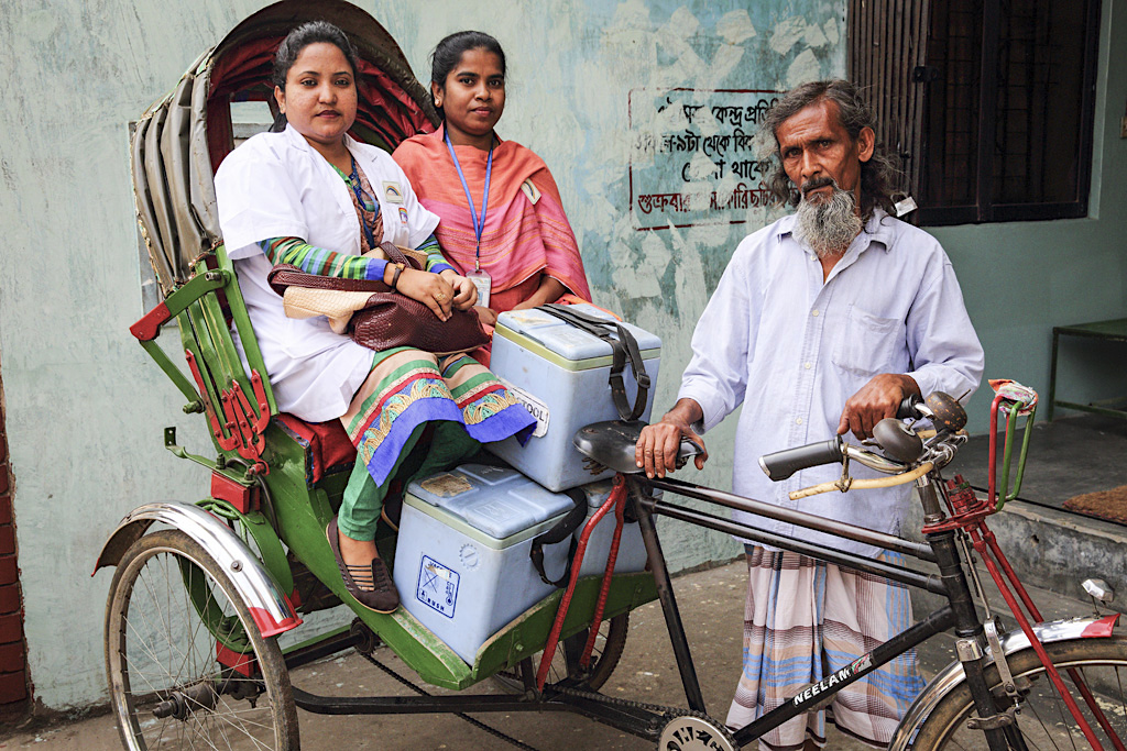 In Bangladesh, a doctor and her assistant prepare to take polio vaccines via rickshaw to families in local slums | Gavi