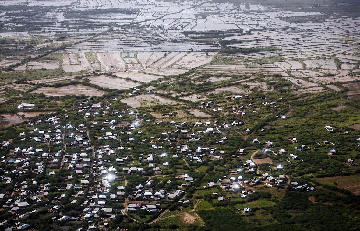 Residential areas and farming fields remain flooded at the outskirts of Beledweyne, Somalia. The rains have forced thousands of people to leave their houses and look for humanitarian assistance while living in displacement camps.   LUIS TATO/AFP via Getty Images