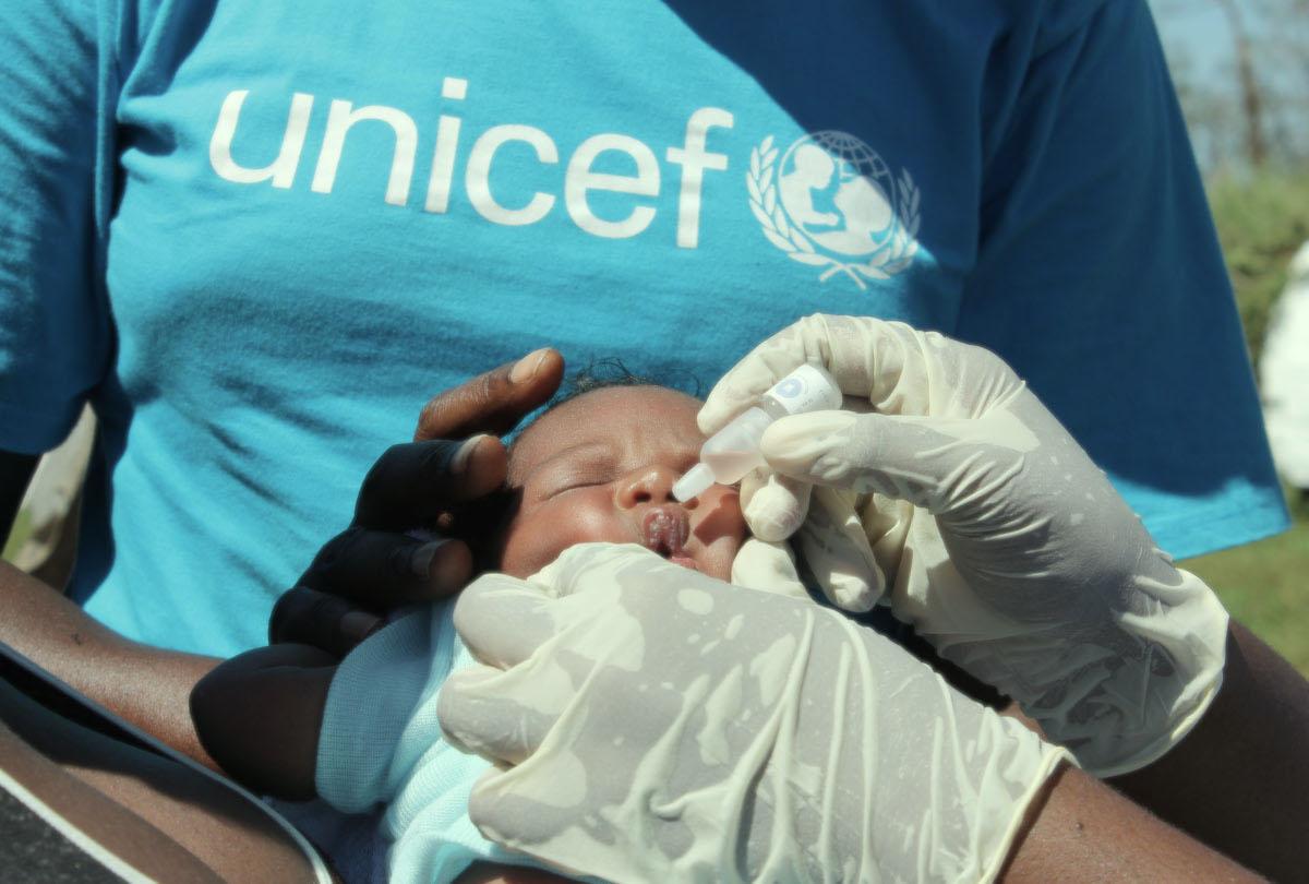 A child in Vanuatu is vaccinated against polio | UNICEF via Getty Images