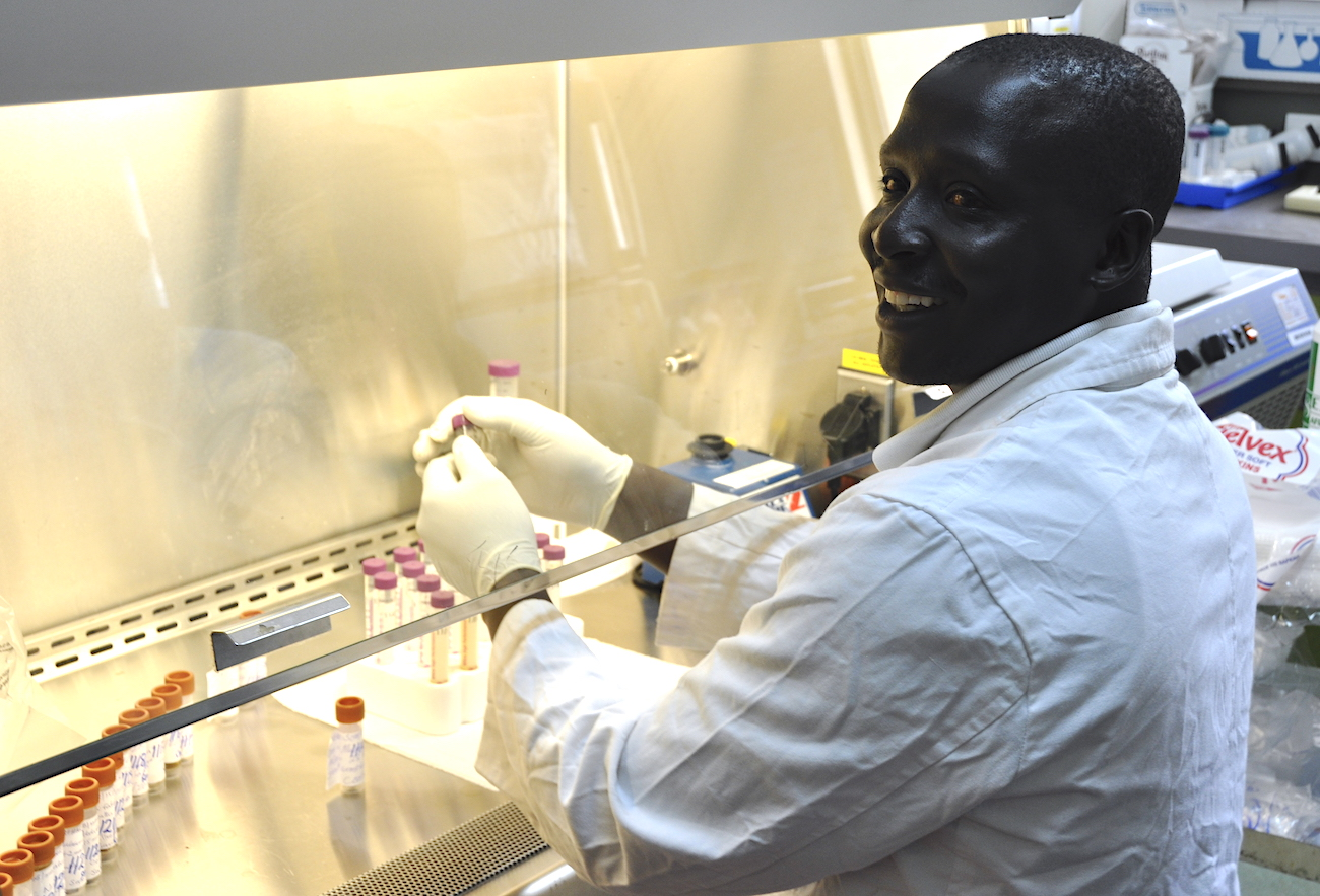 A lab technician in Kenya works with samples to test for poliovirus.