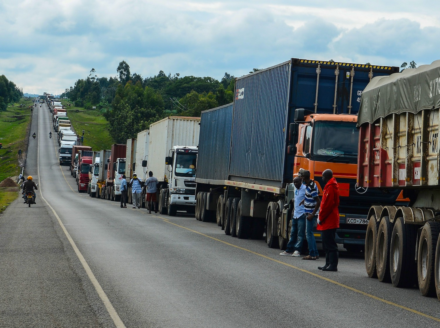 Trucks wait in a line on the road to enter Uganda in Malaba, a city bordering with Uganda, western Kenya, on April 29, 2020.
