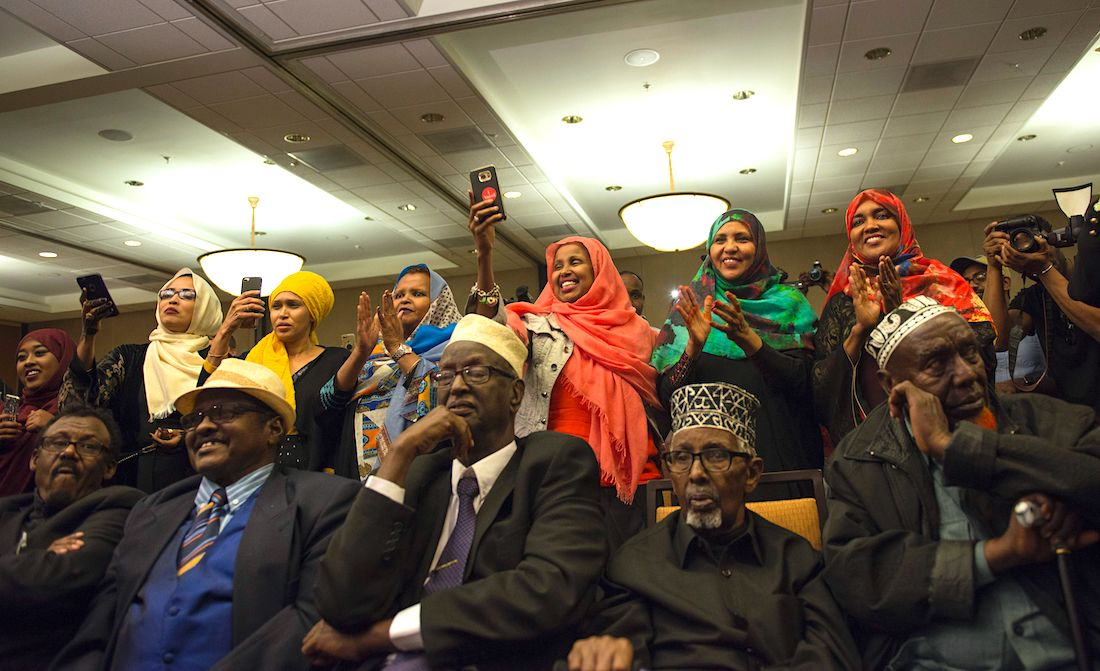 Supporters of Ilhan Omar, candidate for State Representative for District 60B in Minnesota, celebrate on election night, November 8, 2016 in Minneapolis, Minnesota. Omar, a refugee from Somalia, is the first Somali-American Muslim woman to hold public office. |STEPHEN MATUREN/AFP via Getty Images