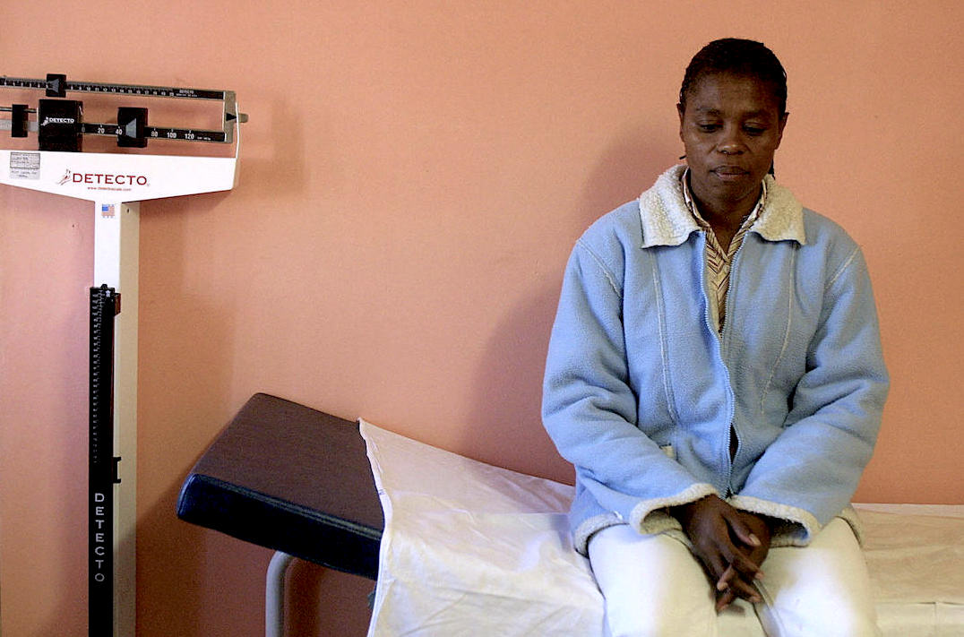 A woman waits to see a doctor in an HIV/AIDS clinic in Cape Town