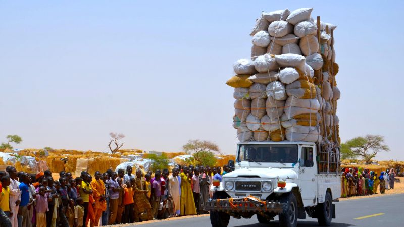 An overloaded truck travels through a refugee camp close to the Niger-Nigeria border in 2016
