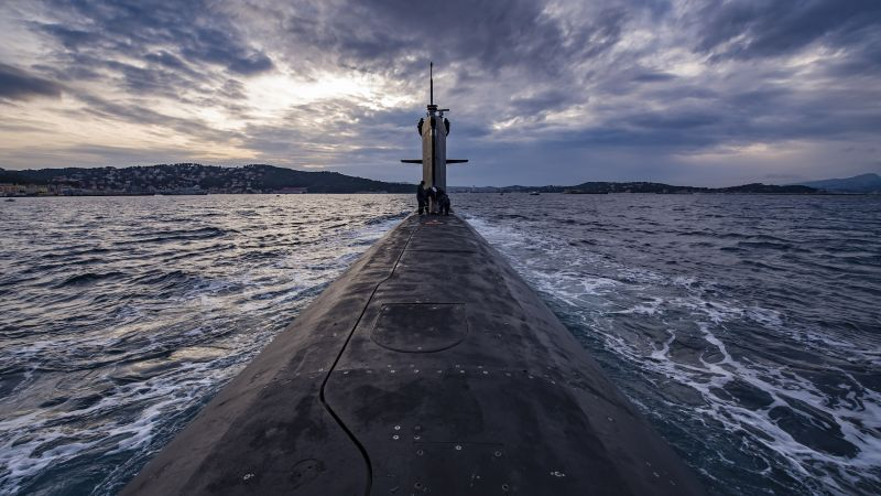 "In the Mediterranean Sea, the nuclear submarine ""Saphir"" surfaces during training exercises in 2009 off Toulon, France. 